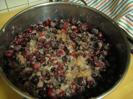 pot of pitted cherries and sugar