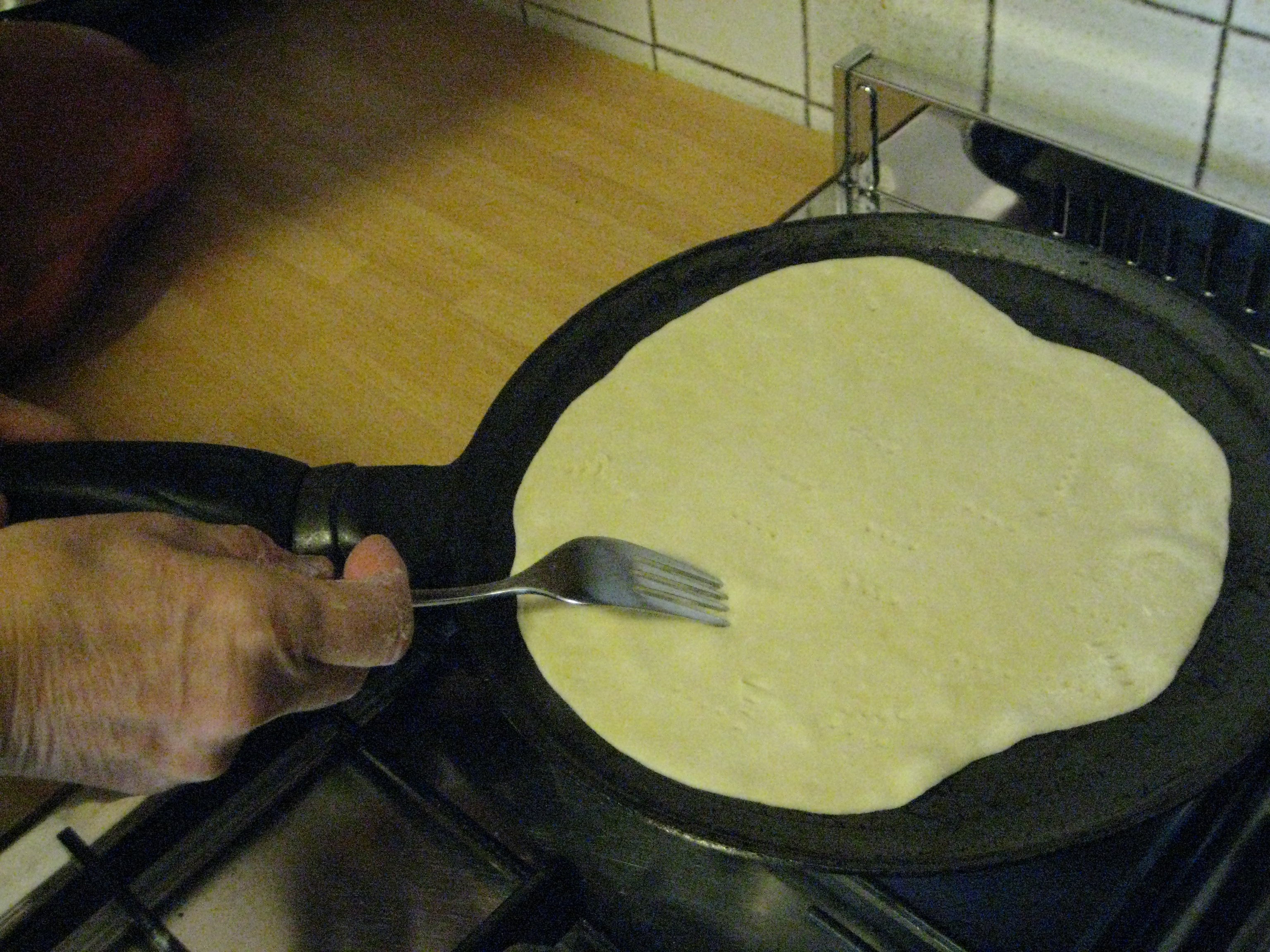 lay the piadina on a hot hot-pan and move continuously, piercing the ...