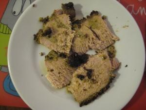 a serving of herb pork tenderloin in a dish