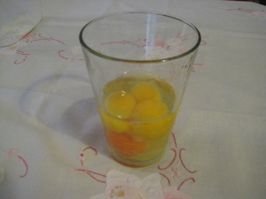 shelled eggs in a glass