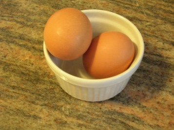two eggs in a bowl