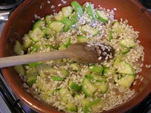 Sauté the onion, the toss in the rice and zucchini. Hold the tomatoes!Th