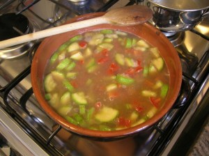 Toss in the diced tomatoes and cover with vegetable broth