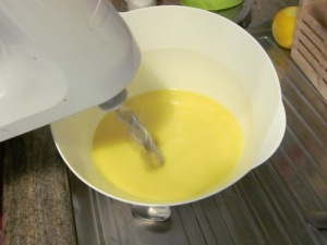 Pour milk into butter, mix