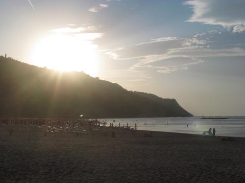 Sunset at Flaminia Bay under the San Bartolo hill