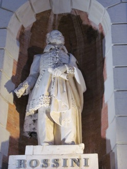 A statue of Gioachino Rossini in the Post Office façade