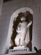 A statue of Giulio Perticari in the façade of the Post office
