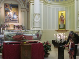 Grandma Lella and Costanza lighting candles in the Cathedral on Saint Patron Day