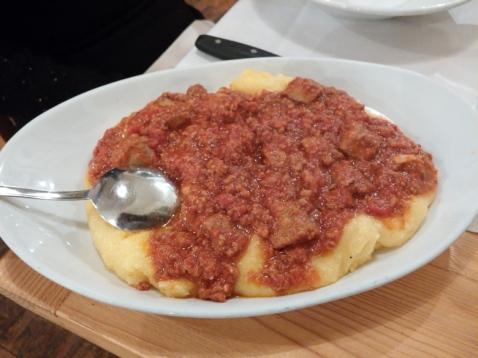 Polenta with sausage and ribs ragu