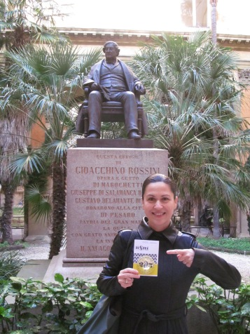 Me, in front of the statue of Rossini in the inner garden of the Music Conservatory
