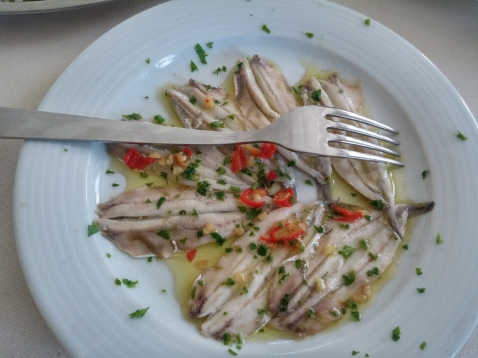 Marinated anchovies. The chillies are fiery.